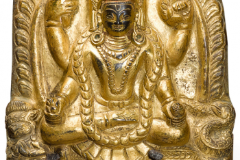 A GILT-COPPER REPOUSSÉ PLAQUE DEPICTING VISHNU