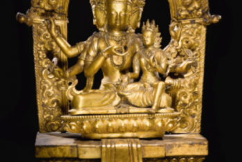 A GILT-COPPER SHRINE OF MAHA AKSHOBYA AND CONSORT Nepal, dated by inscription 1784