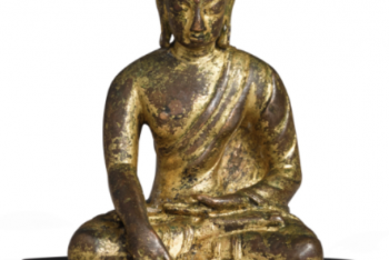A SMALL COPPER ALLOY FIGURE OF BUDDHA