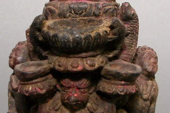 Lamp with Deified Figure Upheld by Garuda