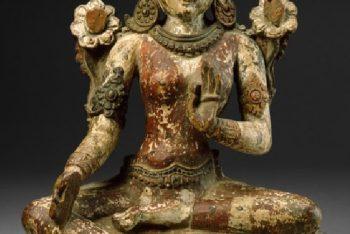 Seated figure of Tara wearing a foliate crown