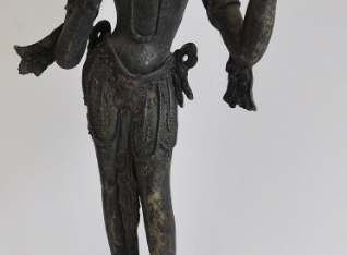 Dhūpa-Tārā standing on a round lotus base