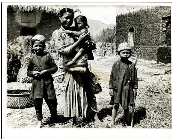 Nepalese mother and three children